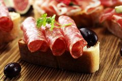 Sandwich with prosciutto or salami or crudo. Antipasti gourmet b stock photography