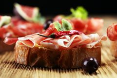 Sandwich with prosciutto or salami or crudo. Antipasti gourmet b stock photo