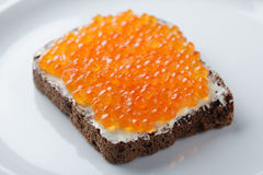 Sandwich with red caviar Stock Image