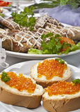 Sandwich with red caviar. Sandwiches with red caviar on a plate Royalty Free Stock Photos