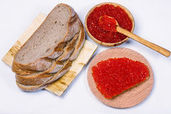 Sandwich with red caviar bowl with red caviar and bread Royalty Free Stock Images