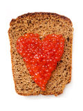 Sandwich with red caviar. Bread with red caviar from heart shape Royalty Free Stock Photos