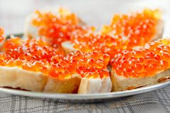 Sandwich with red caviar, butter and wheat bread closeup royalty free stock image