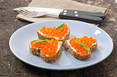 Sandwich with red caviar Royalty Free Stock Photo