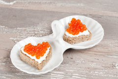 Sandwich with red caviar in the form of a heart Royalty Free Stock Image