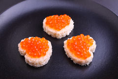Sandwich with red caviar in a heart shape Royalty Free Stock Image