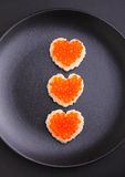 Sandwich with red caviar in a heart shape Royalty Free Stock Images