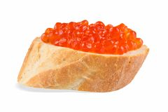 Sandwich with red caviar, red caviar on baguette on white background, close-up, side view. royalty free stock photo