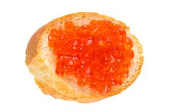 Sandwich with red caviar, red caviar on baguette isolated on white background, close-up, top view. stock photos