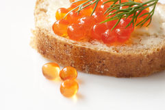 Sandwich with red caviar Stock Photos