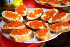 Sandwich with red caviar on white bread. Festive Christmas table. Celebrate the New year. Stock Image