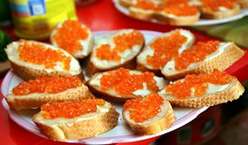 Sandwich with red caviar on white bread. Festive Christmas table. Celebrate the New year. Stock Photo