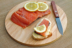 Sandwich with red fish and slice of lemon Stock Image
