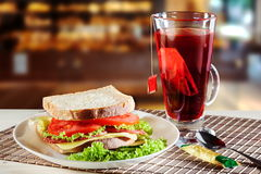 Sandwich and red fruit tea Royalty Free Stock Image