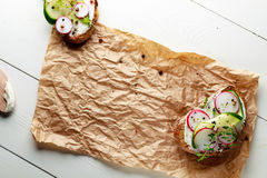 Sandwich with red radish, cucumber and fresh herbs. And pepper.Top view with copy space Royalty Free Stock Photo