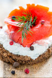 Sandwich with red salmon, cheese and dill. Royalty Free Stock Photos