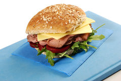 Sandwich of roast beef and chesse roll on book Royalty Free Stock Photo