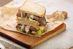 Sandwich with roast beef, lettuce and truffle sauce Royalty Free Stock Photography