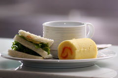 Sandwich roll cake and cup of coffee Royalty Free Stock Photo