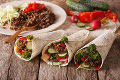 Sandwich roll stuffed with beef and vegetables close-up. horizon Stock Photos
