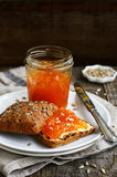 Sandwich with rye bread, apricot jam and sunflower seeds Royalty Free Stock Photos
