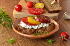 Sandwich of rye bread with cream cheese, tomatoes Stock Photography