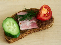 Sandwich rye bread. Rye bread sandwich with vegetables and ham Royalty Free Stock Photos