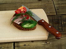 Sandwich rye bread. Rye bread sandwich with vegetables and ham Royalty Free Stock Photo
