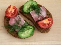 Sandwich rye bread. Rye bread sandwich with vegetables and ham Stock Photo