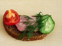 Sandwich rye bread. Rye bread sandwich with vegetables and ham Stock Photography