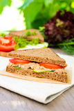 Sandwich with rye brown bread, ripe tomatoes, cucumbers and tuna fish for healthy snack Stock Images