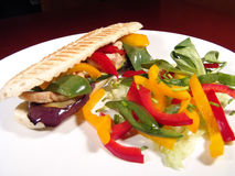 Sandwich&Salad. Sandwich made of grilled turkey and vegetables served with fresh salad royalty free stock image