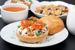 Sandwich with a salad of cottage cheese, tomato, salmon, muesli Stock Photos