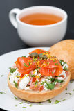 Sandwich with salad of cottage cheese, tomato and salmon and tea Stock Images