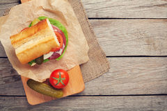 Sandwich with salad, ham, cheese and tomatoes Royalty Free Stock Photo