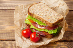 Sandwich with salad, ham, cheese and tomatoes Stock Images