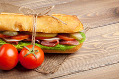 Sandwich with salad, ham, cheese and tomatoes Royalty Free Stock Photography
