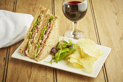 Sandwich with salad and potato chips Stock Image