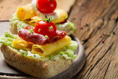 Sandwich with salami, chive and lettuce Stock Photo