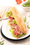 Fresh sandwich. Sandwich with salami and salad Royalty Free Stock Image