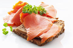 Sandwich with salmon. Wild salmon on the bread slices Royalty Free Stock Photos