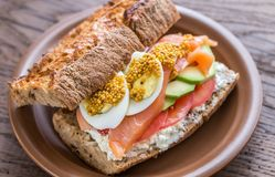 Sandwich with salmon, avocado and eggs Royalty Free Stock Images