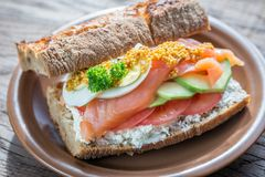 Sandwich with salmon, avocado and eggs Royalty Free Stock Photos