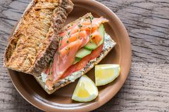 Sandwich with salmon, avocado and tomatoes Royalty Free Stock Image