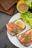 Sandwich with salmon for breakfast Royalty Free Stock Photo