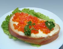 Sandwich with salmon caviar Stock Photos