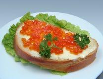 Sandwich with salmon caviar stock photos