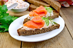 Sandwich with salmon and cream in a dish with cucumber Royalty Free Stock Photo