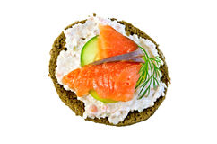 Sandwich with salmon and cream on top Stock Images