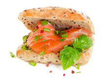 Sandwich with salmon for healthy breakfast isolated on a white. Royalty Free Stock Photo